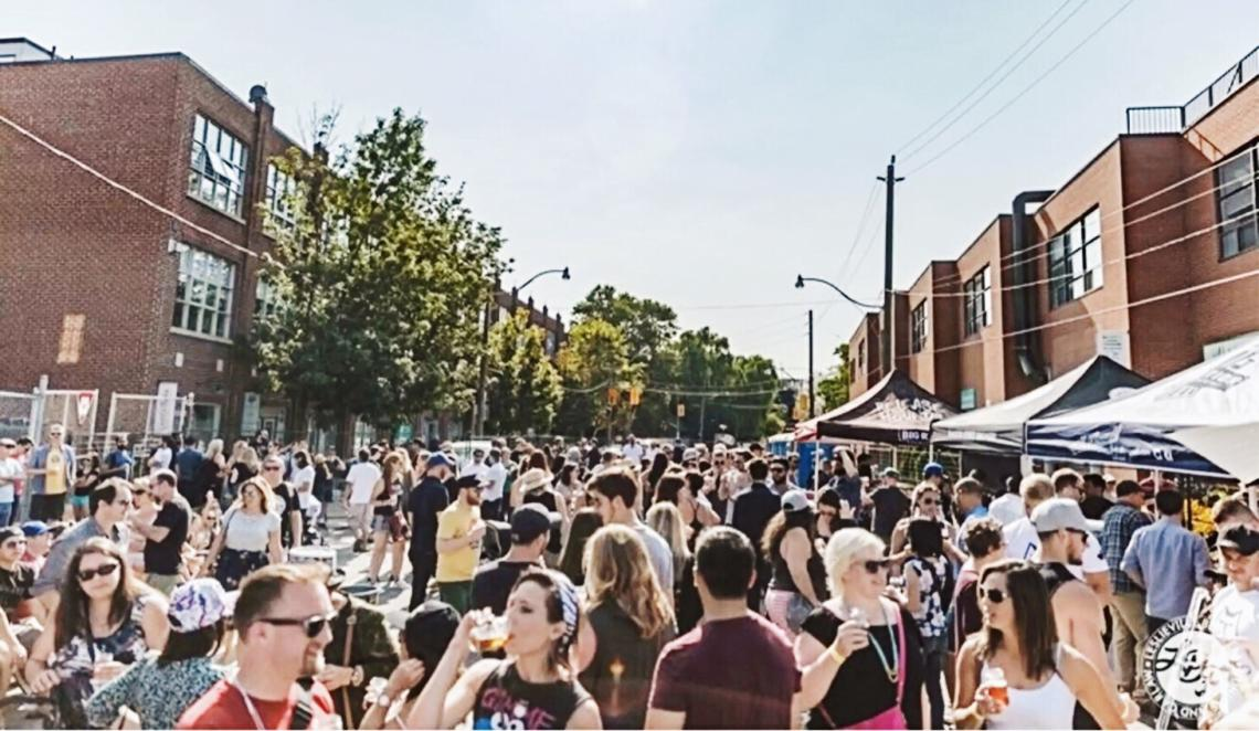 Leslieville beer fest view on Dundas Street East from Carlaw Avenue looking west toward Logan Avenue